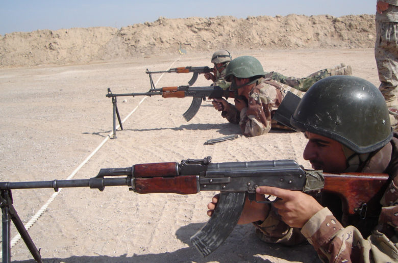 04-	CAMP HABBANIYAH, Iraq – Iraqi Soldiers aim in thier RPK light machine guns during the Iraqi Small Arms Weapons Instructor Course taught by the Marines of the 2nd Marine Division Training Center here.